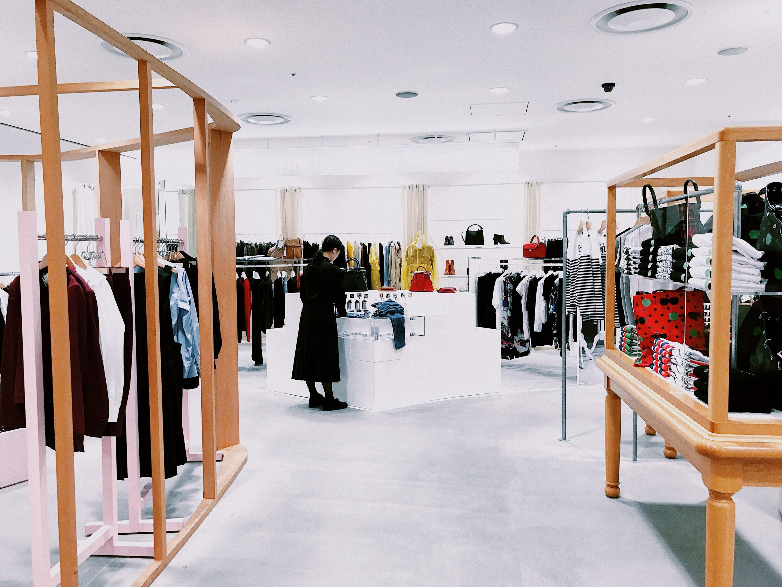 woman standing inside clothing area